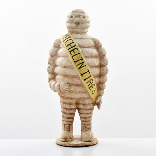 Cast-iron three-dimensional figure of Michelin Tires mascot 'Bibendum.' Sold for $2,080