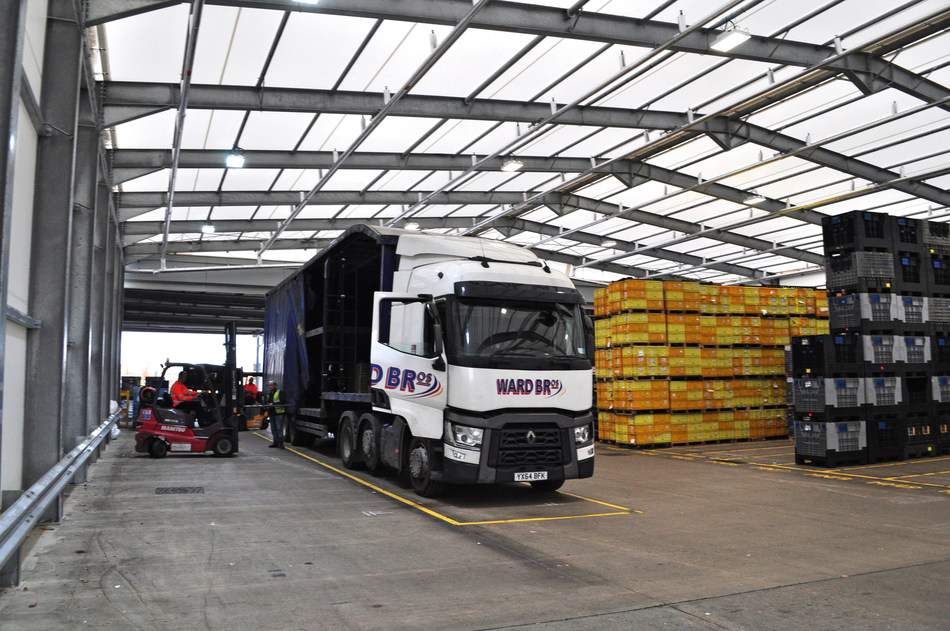 unloading of materials under Nifco's new storage facility