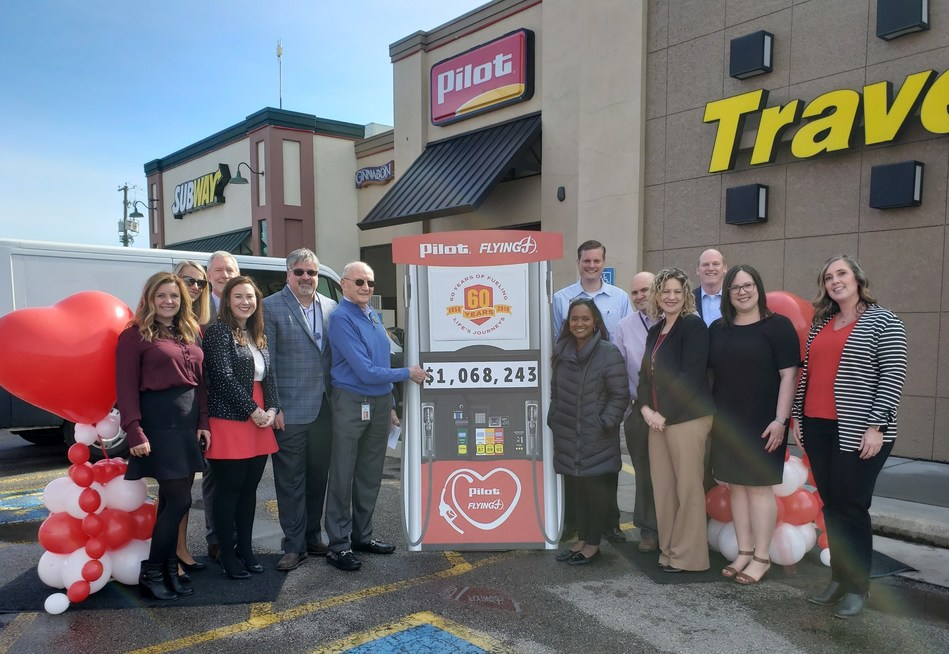 """Pilot Flying J announces the amount raised in support of the American Heart Association's """"Life Is Why We Give™"""" campaign, presenting a total of $1,068,243 to the organization at a celebration on March 12 at the Pilot Travel Center on Strawberry Plains Pike near the company's headquarters in Knoxville, Tennessee. Pilot Flying J and American Heart Association representatives pictured from left: Blair Ware, Bev Miller, David Markiewicz, Sarah MacPhail, Mike Rodgers, Pilot Flying J Founder and Chairman Jim Haslam, Meg Counts, Spencer Ross, Tim Wroblewski, Julie Taylor, Paul Duncan, Danica Powell and Mindy Savage."""