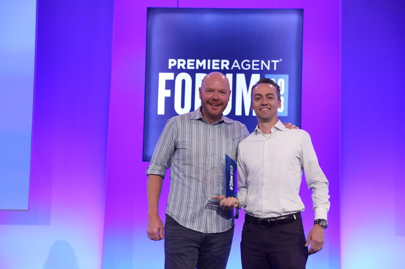David Ness and Tim Aberle on stage at the Zillow Premier Agent Forum in Las Vegas receiving the award for #1 in the Country for Client Experience.