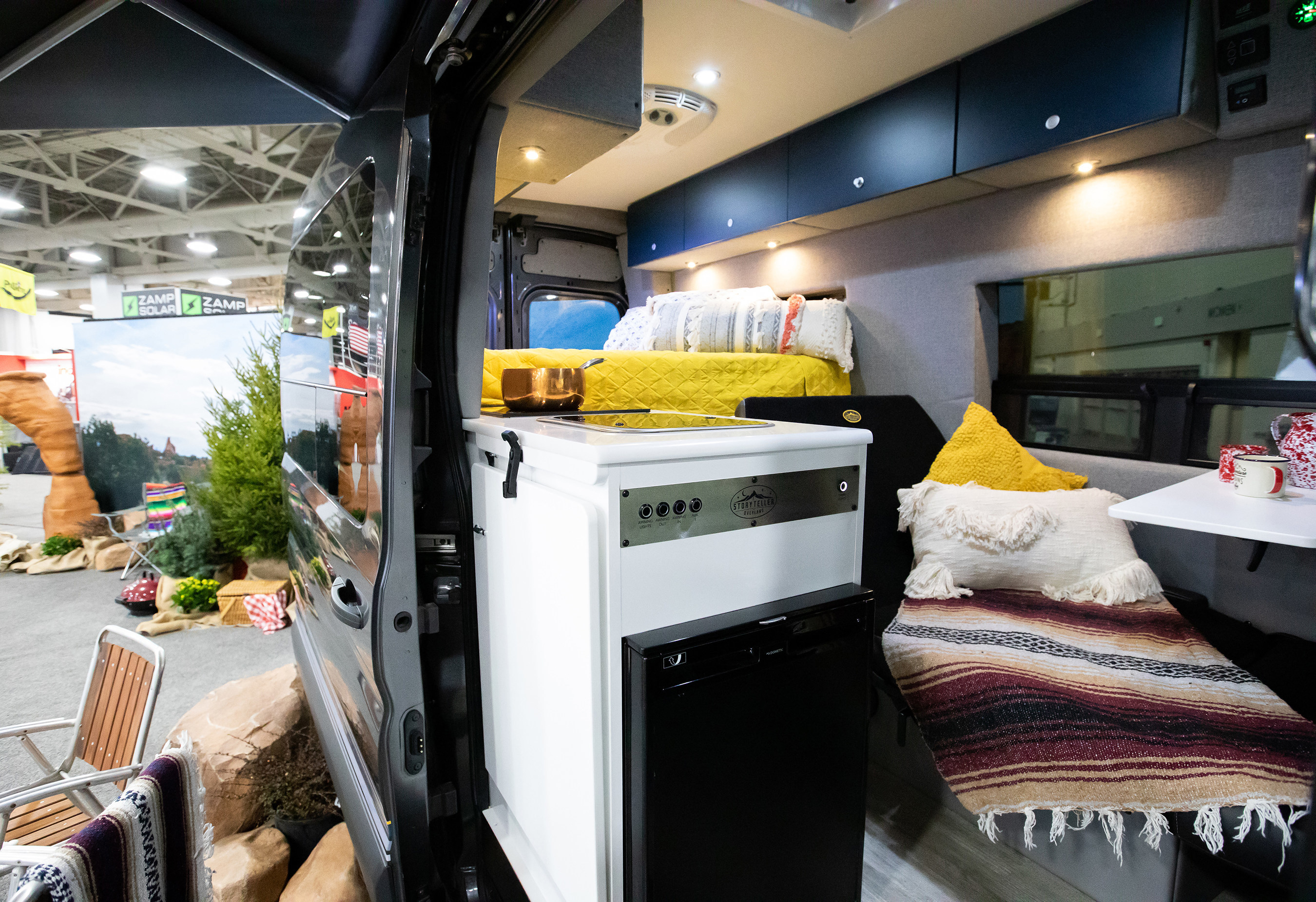 The interior of the all new Storyteller Overland MODE 4x4 shown here on the Ford Transit platform in the Van Life Vignette at the recent RVX Expo in Salt Lake City, Utah.