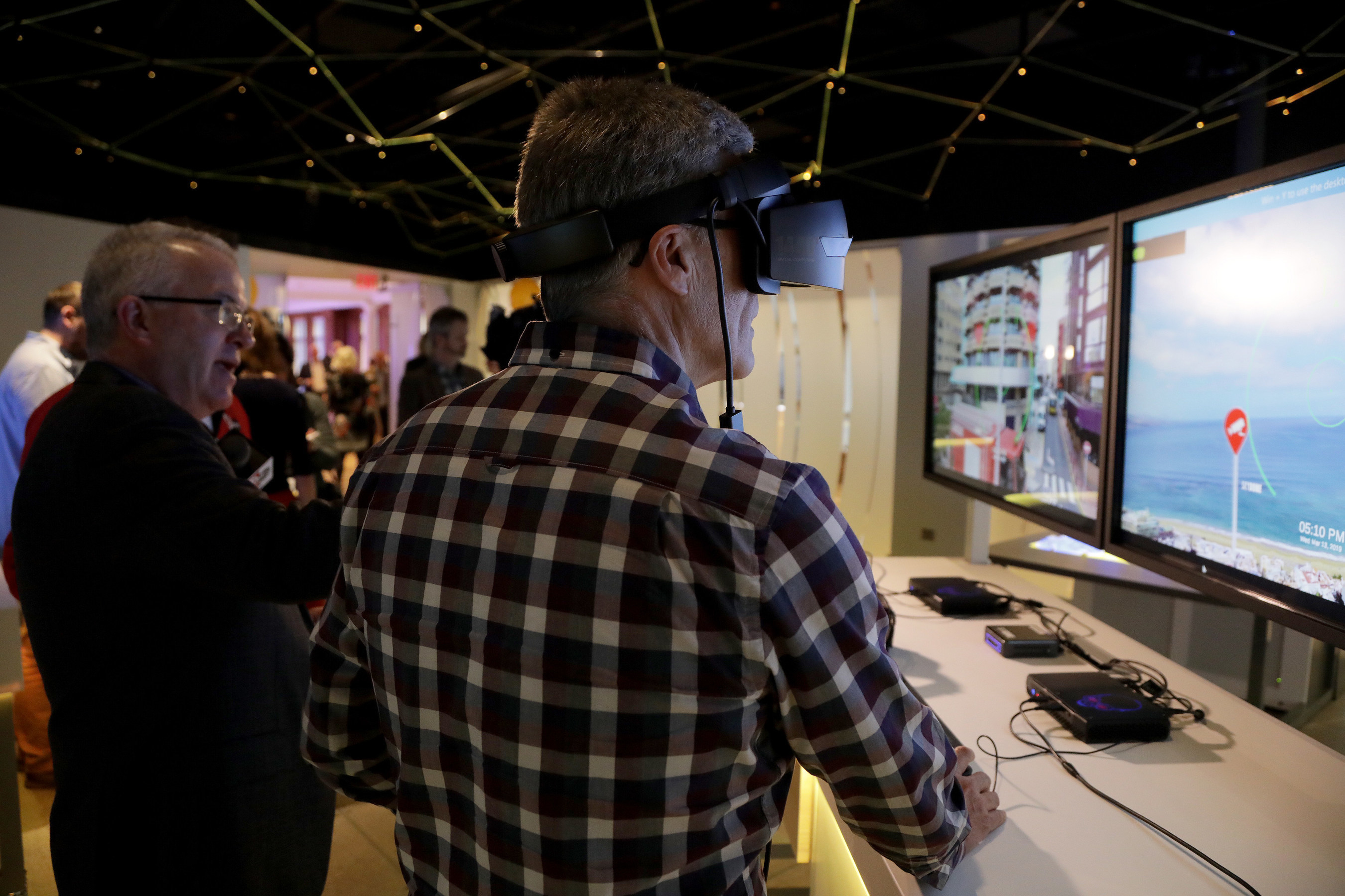 Guests take part in a virtual reality 5G demonstration at the Sprint 5G Experience.