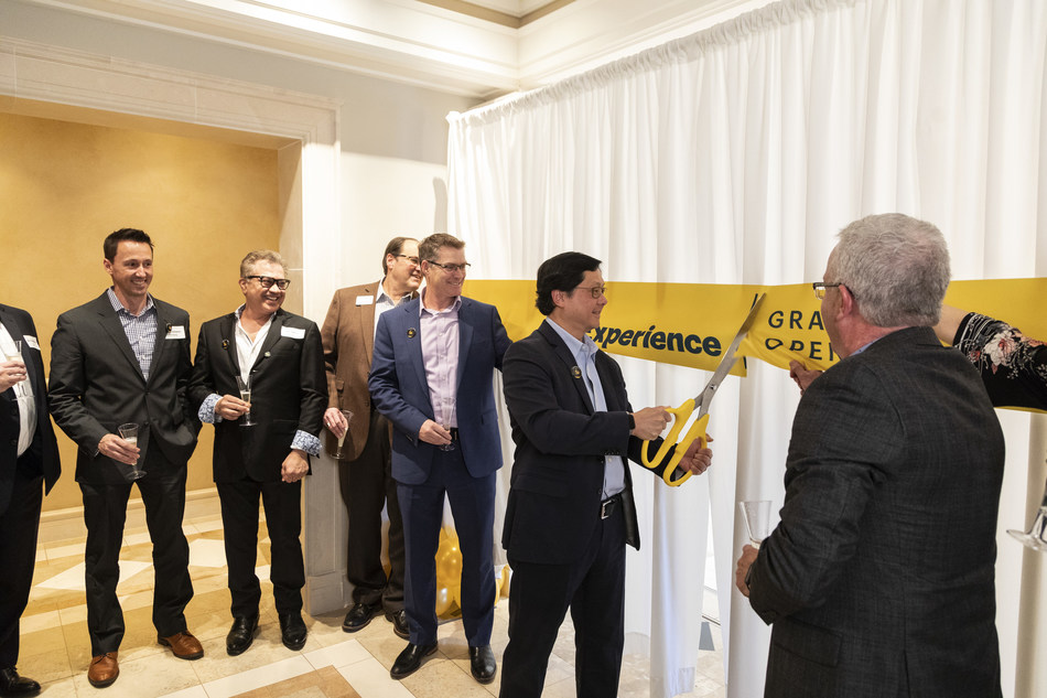 Dr. John Saw, Sprint chief technology officer cuts the ribbon at Sprint 5G Experience located in Overland Park, Kan.