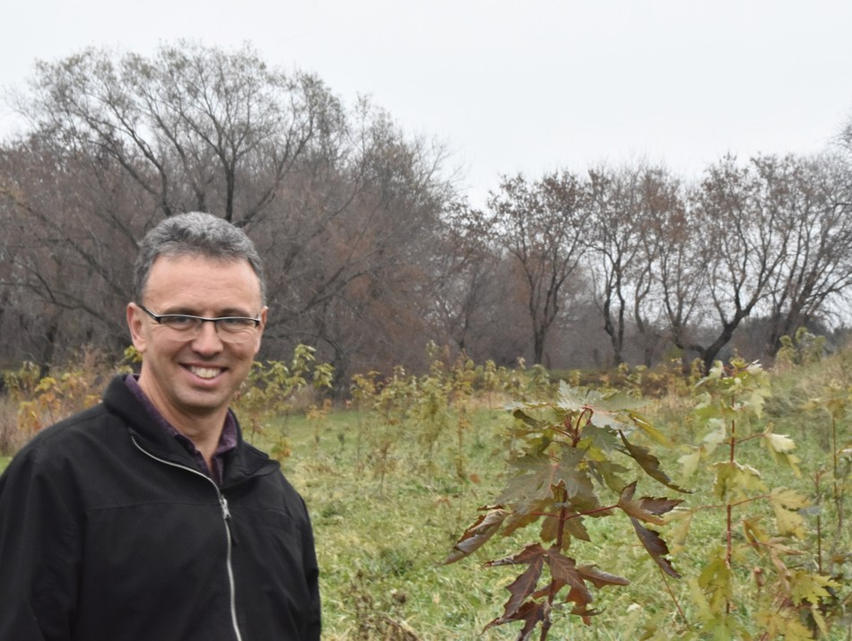 André Brisson with his young forest. (CNW Group/Forests Ontario)