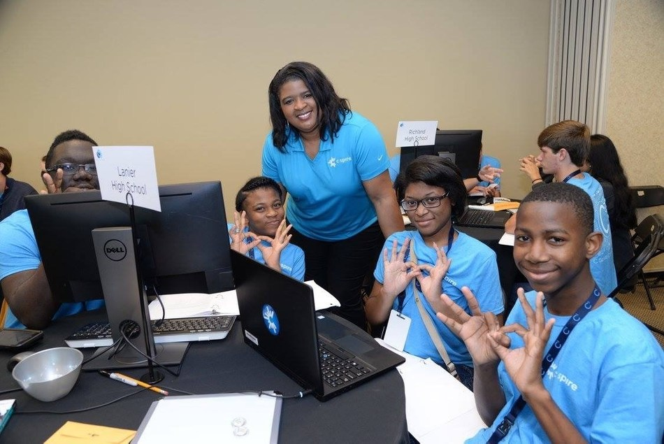 C Spire CIO Carla Lewis encourages Lanier High School students during a company-hosted coding challenge in October 2018.  Over 130 students from 33 public and private high schools in 24 counties across the state will compete for scholarships and other tech-related prizes in the firm's upcoming March 21 regional coding challenge.  Four previous competitions since April 2017 have reached over 380 students from 88 high schools in 49 Mississippi counties.