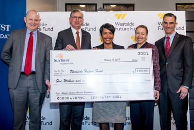 The SunTrust Foundation presents a $5 million grant to the Westside Future Fund to support affordable housing and economic development. Left to right: John Ahmann, Executive Director of Westside Future Fund; Bill Rogers, Chairman & CEO of SunTrust and SunTrust Foundation Chairman of the Board; Atlanta Mayor Keisha Lance Bottoms; Dr. Beverly Tatum, Westside Future Fund Vice Chairman; and Richard Dugas, Westside Future Fund Chairman.