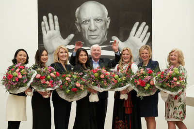 Viking Chairman Torstein Hagen and godmothers of the seven newest Viking river ships in front of a photo of Pablo Picasso, displayed as part of the Picasso Panorama exhibit at the Fondation Beyeler museum in Basel, Switzerland ? where Viking held the gala dinner following the naming ceremony. For more information, visit www.vikingcruises.com.