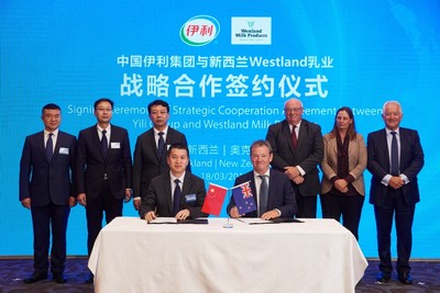 Representatives from China's Yili Group and Westland Milk in New Zealand signed a conditional agreement in Auckland on March 18.