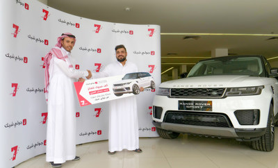 Representing Jollychic, on the left, Mr. Abdullah Al-Faify with the winner, on the right, Mr. Mohammed AlOnezi