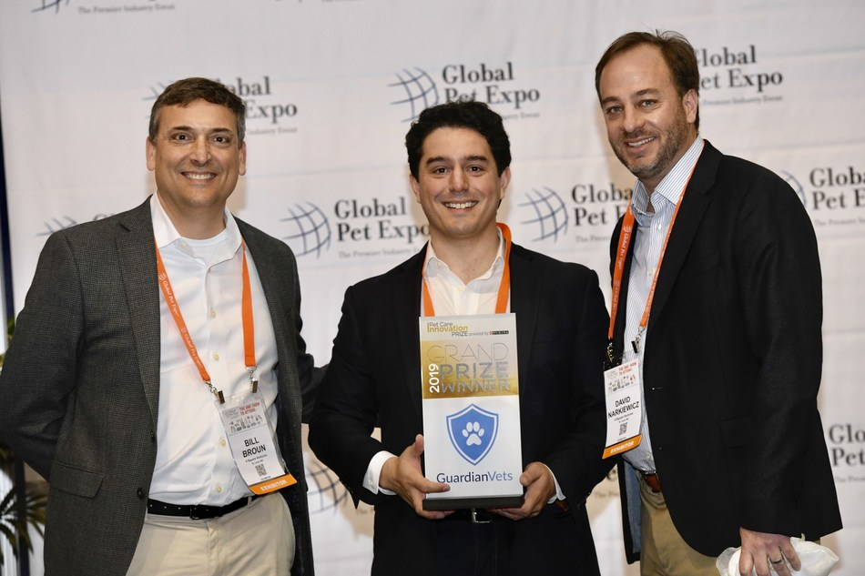 John Dillon (center), founder of GuardianVets and grand prize winner of the 2019 Pet Care Innovation Prize, accepts his award at Global Pet Expo in Orlando on March 21, 2019 from Bill Broun (left) and David Narkiewicz (right) from Purina. The Pet Care Innovation Prize is a collaborative effort of Purina's 9 Square Ventures division with investing leaders, Active Capital, to support and connect with early stage pet care startups.