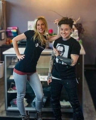 Invisible Ink Tattoo Removers' Minneapolis General Manager, Darcy Blasing, with Emi Nijiya, owner of Jackalope Tattoo.