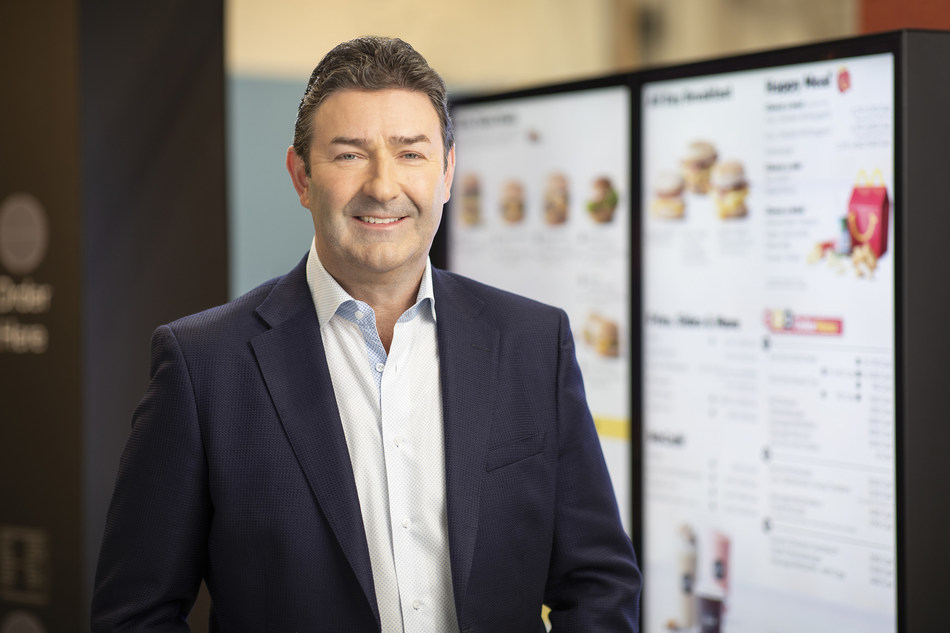 McDonald's President and Chief Executive Officer Steve Easterbrook pictured in front of a drive-thru digital menu board, which will utilize Dynamic Yield's decision logic technology to enhance the customer experience.