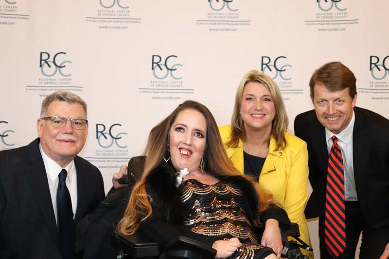 L-R: RCOC Executive Director Larry Landauer, Self-Advocate Spotlight Award honoree Jennifer Bright, KCAL9/KCBS2's Michele Gile, RCOC Board Chair Alan Martin.