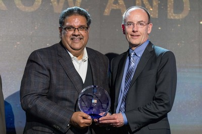 Murthy Renduchintala, chief engineering officer and group president of the Technology, Systems Architecture & Client Group at Intel (left) with Brian Trafas, executive vice president of KLA's Global Customer Organization (right). Photographer: Chip Holley Productions.