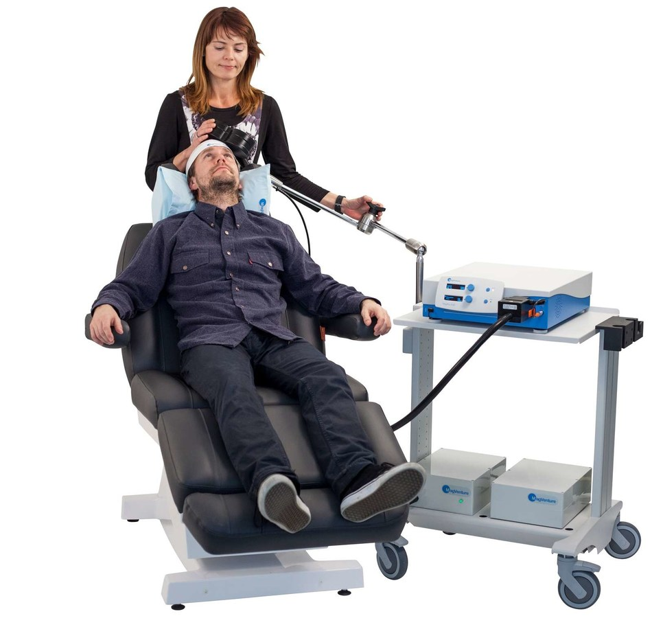 Patient being treated for depression without anti-depressants with new, quick TMS magnetic therapy stimulation.