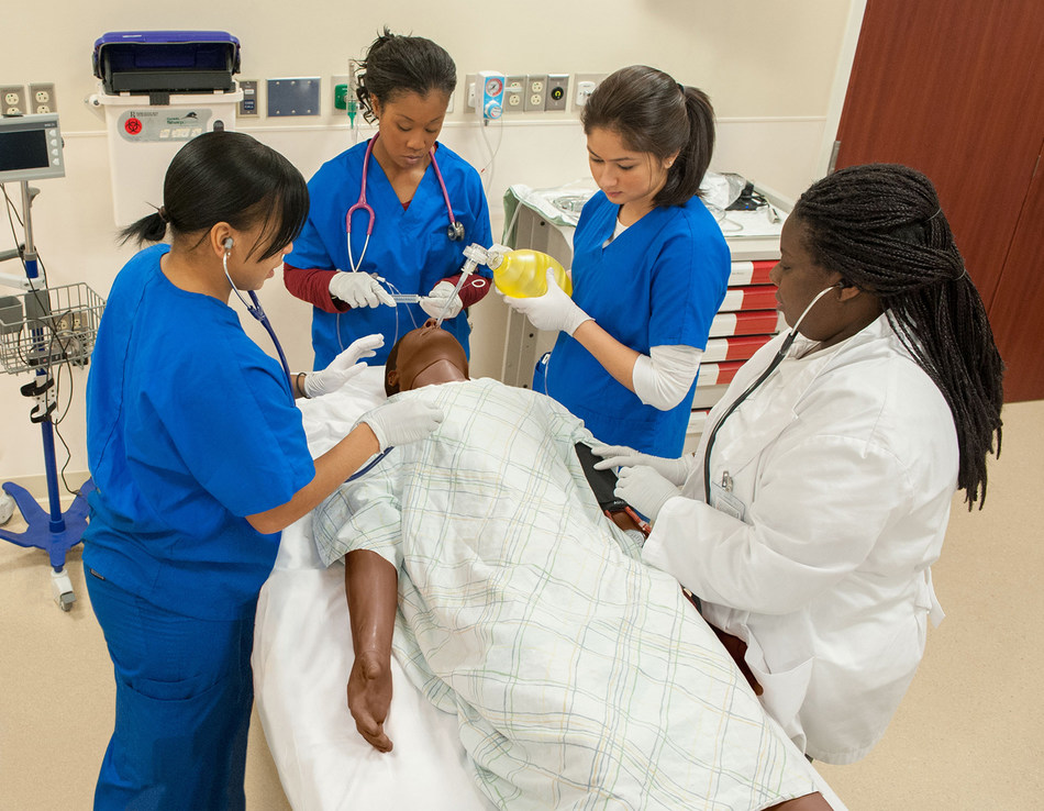 Learners work together as a team to perform clinical tasks on SimMan® 3G.