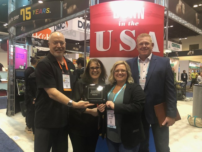 Marshall Pet Products' Paul Juszczak and Cristina Roth present the Retailer of the Year Award to Petland's Cassie Mash and President Joe Watson.