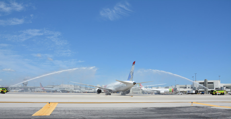 Norwegian's new service receives a water-cannon salute from Miami-Dade County.
