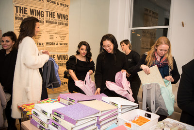 Guests and attendees pack donation backpacks to be donated to International Rescue Committee