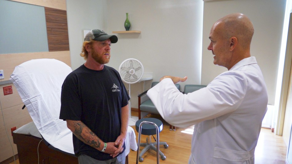 Okyanos orthopedic and stem cell therapy specialist Dr. Michael Price consults with Special Forces veteran Ike Atlas.