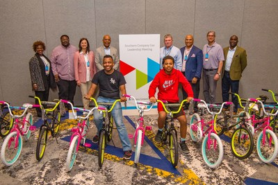 Southern Company Gas executives along with representatives from the Boys and Girls Club of Winder-Barrow display bikes built and donated during a March 28 leadership meeting.