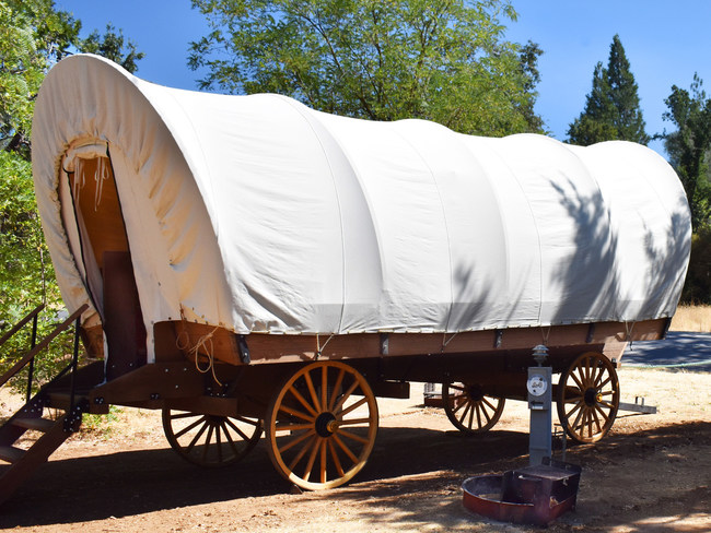 """The Conestoga Wagons at Yosemite Pines have authentic styling but modern amenities for nostalgia that transcends every generation. Put some """"Pioneer Spirit"""" in your next vacation, and because Yosemite Pines is just 22 miles from Yosemite National Park's western gate, staying in these very popular wagons is perfect for day trips into the park or throughout California's historic Gold Country."""