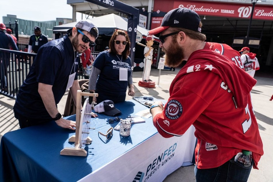 A fan spins to win a PenFed giveaway item during opening day at Nationals Park on March 28, 2019.