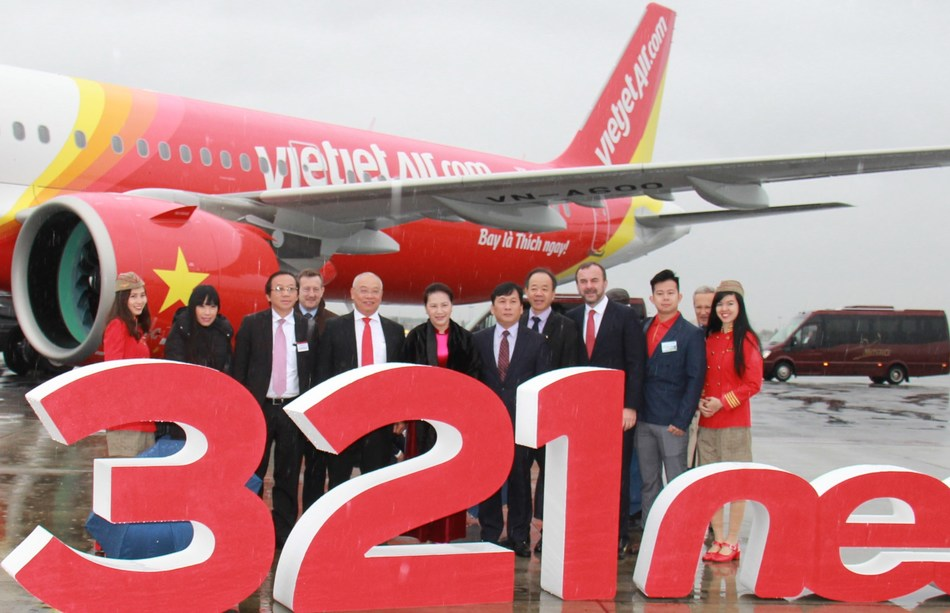 Vietnamese National Assembly Chairwoman Nguyen Thi Kim Ngan with fellow dignitaries from the National Assembly as well as executive representatives of Vietjet and Airbus join the cutting of the red ribbon at the delivery ceremony of the new A321neo