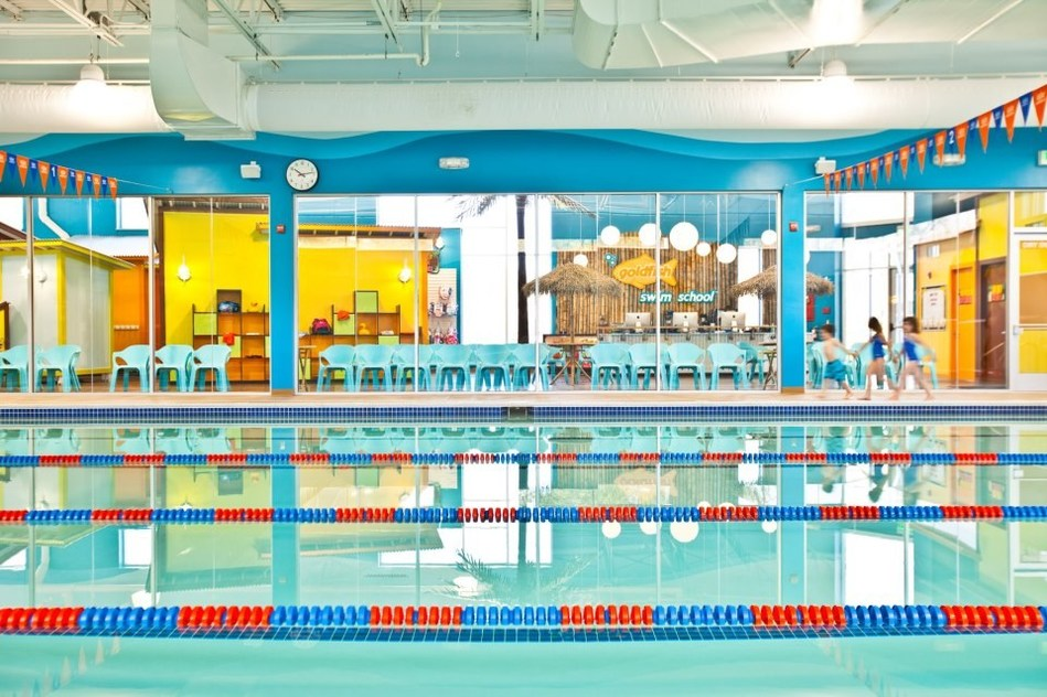 Goldfish Swim School's Northern Virginia indoor facilities feature bright colors, palm trees, heated pool decks and a 25-yard pool heated to 90 degrees.