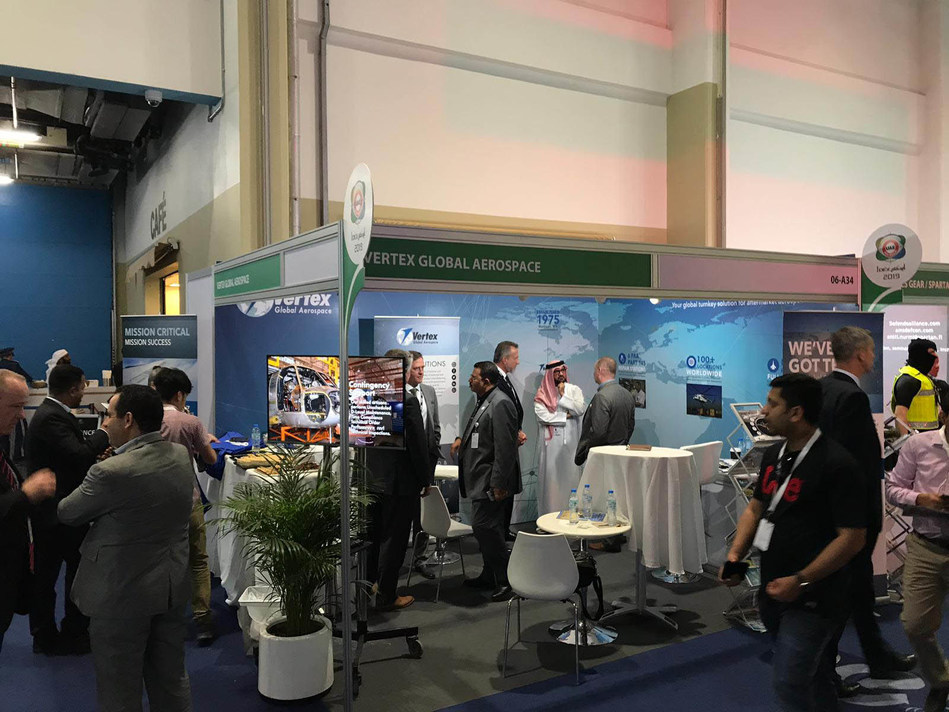 Members of the Vertex Global Aerospace business line visit with guests while exhibiting at the International Defence Exhibition and Conference in Abu Dhabi, United Arab Emirates, February 17, 2019. Vertex Aerospace opened a headquarters office in Abu Dhabi in March that will be run by its recently established VGA business line. Courtesy Photo.