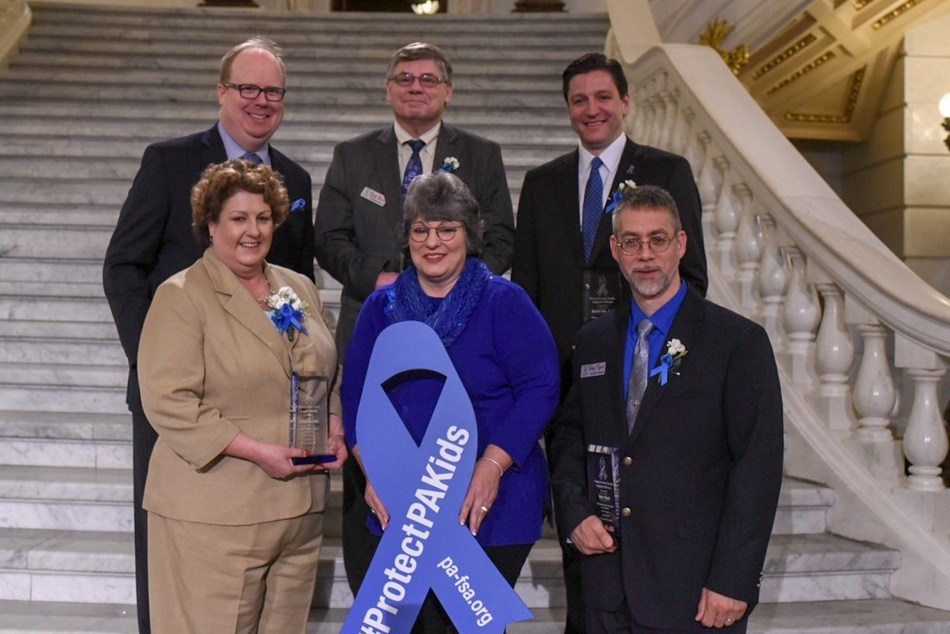 2019 Pa Blue Ribbon Champions for Safe Kids Award Winners:Kyle Girmes, WGAL-TV, Rick Wess, CASA volunteer, Daniel Dye, Esq., Senior Deputy Attorney General in the Office of Pennsylvania Attorney General, Patricia Kosinski, Executive Director of Family Support Line, Angela Liddle, MPA, President and CEO of the Pa Family Support Alliance, and Terry Figart, CASA volunteer.