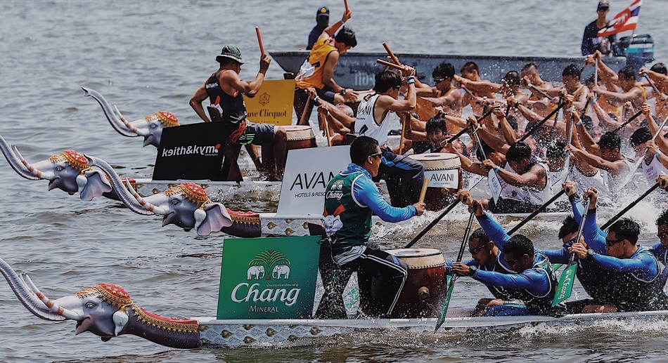 Royal Thai Navy Seals - Chang Mineral Water Team paddling to victory in the King's Cup Elephant Boat Race