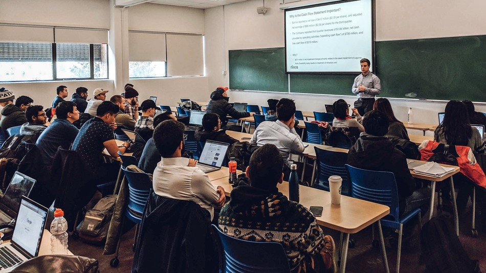 Dylan Kiselbach, Riivos Solutions Architect, leading a mine valuation and financial statements workshop for UBC mining students