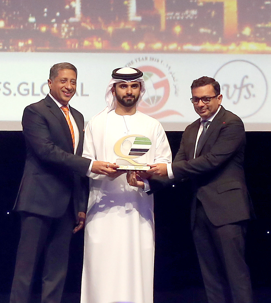 His Highness Sheikh Mansoor bin Mohammed bin Rashid Al Maktoum, President of the Dubai International Marine Club, bestowed the DQGA Award to Zubin Karkaria, CEO, VFS Global Group, (right) and Vinay Malhotra, Regional Group COO – Middle East, South Asia & China, VFS Global (left)