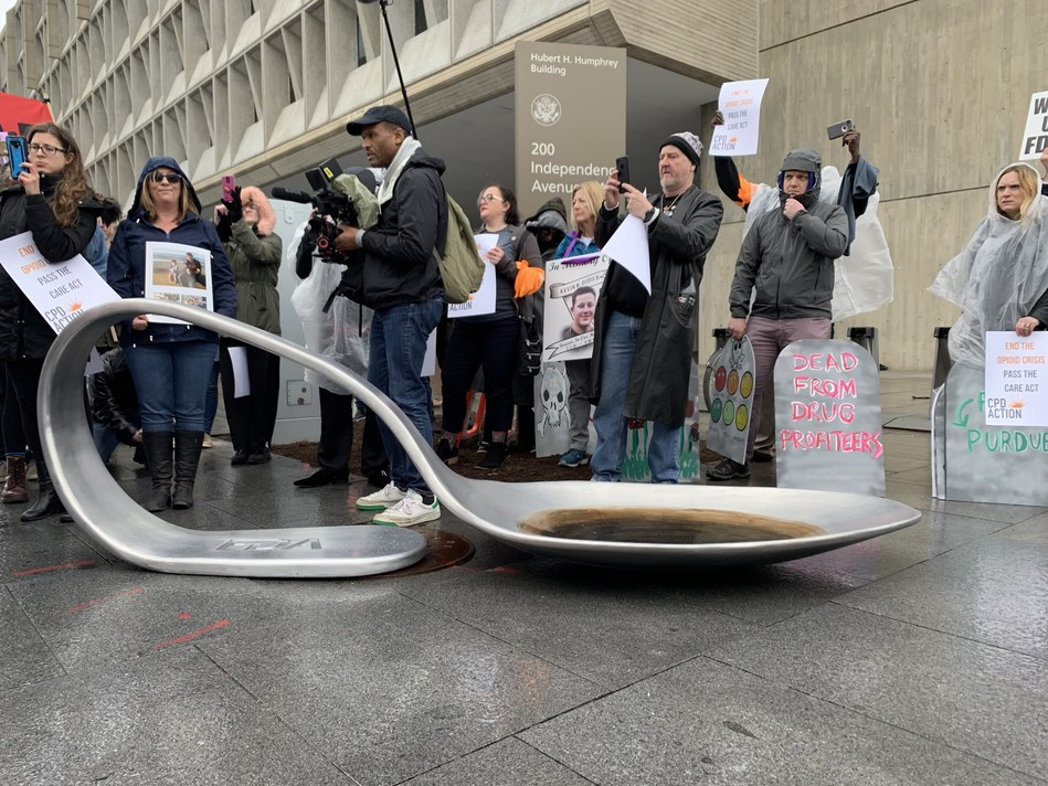 The Opioid Spoon Project dropped an 800-pound metal heroin spoon in front of the Department of Health and Human Services in Washington, DC during the Wake Up FDA action.