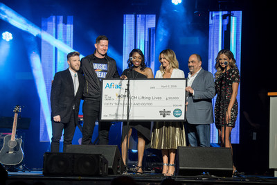Aflac presents a $50,000 donation to Musicians On Call through ACM Lifting Lives® at the ACM Stories, Songs & Stars event on April 5, 2019, in Las Vegas. (L-R) Brandon Ray, 2019 Aflac ACM Lifting Lives Honor recipient; Pete Griffin, president & CEO, Musicians On Call; Shannon Watkins, vice president of Brand & Creative Services, Aflac; Lyndsay Cruz, executive director, ACM Lifting Lives; Paul Barnabee, vice chairman, ACM Lifting Lives; and Carly Pearce, New Female Artist of the Year Nominee.