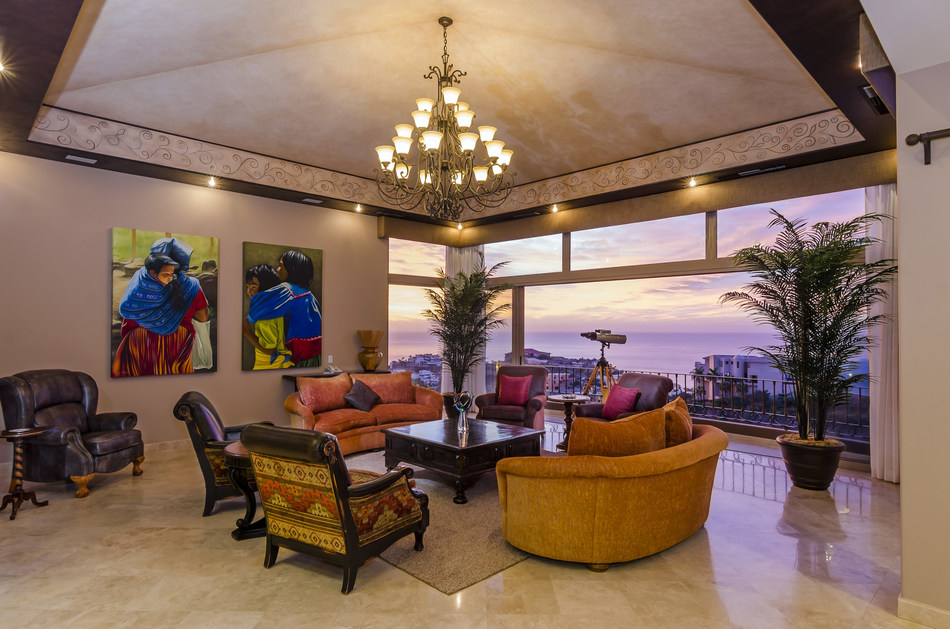 A comfortable salon offers panoramic ocean and sunset views. CaboLuxuryAuction.com