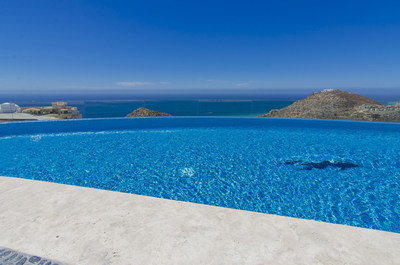 The infinity-edge pool appears to spill right into the sparkling Pacific. CaboLuxuryAuction.com.