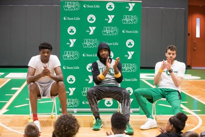 (L to R) Celtics players Rob Williams, Marcus Smart and R.J. Hunter talk health and fitness with kids from YMCAs for the Sun Life Fit to Win program.