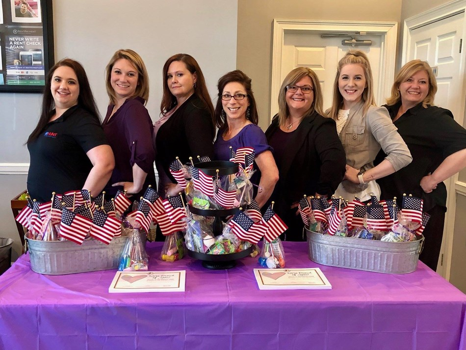 Staff members at Little Rock Family Housing show their support for Month of the Military Child (PRNewsfoto/Hunt Military Communities)