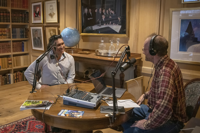 Veteran journalist David McGuffin, host of the Explore podcast, interviews Inuit athlete and actor Johnny Issaluk. (CNW Group/Royal Canadian Geographical Society)