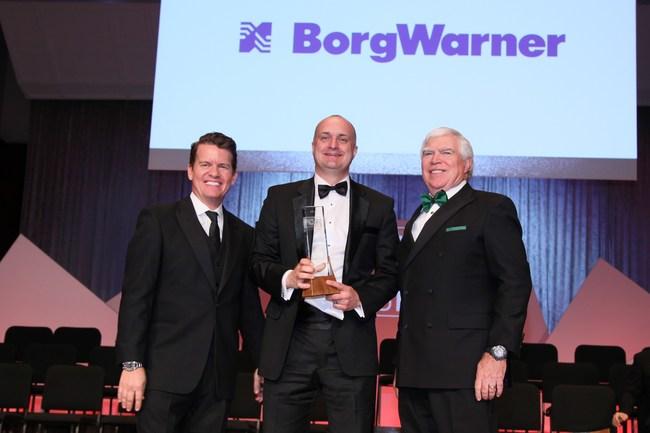 Jason Stein and J Ferron of Automotive News award Mike Ausbrooks (center) of BorgWarner a 2019 PACE award