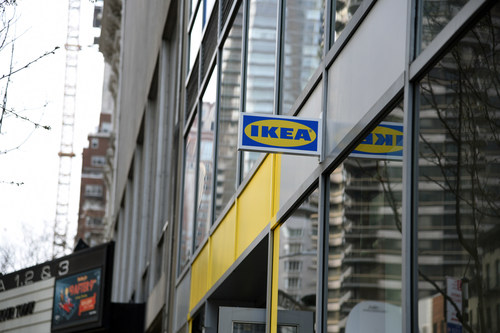 """A sign reading """"IKEA"""" in classic brand colors hangs on the side of the IKEA Planning Studio in New York, New York opening April 15th, 2019. Credit: IKEA U.S. Photographer: Elisha Holmes"""