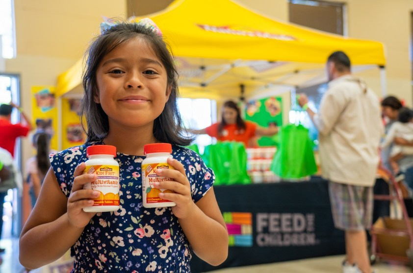 Feed the Children and Nature Made providing food and essentials to families at a community distribution event in Los Angeles.