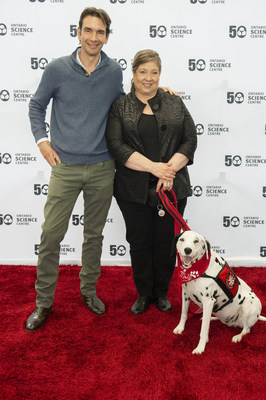 Taran Davies (Producer, Cosmic Picture), Dayna Hilton (Executive Director, Keep Kids Fire Safe Foundation) and Molly the Fire Safety Dog at the advance screening of Superpower Dogs at the Ontario Science Centre on April 11.   The new IMAX documentary film, which opens on April 12, follows six four-legged heroes from around the world. (CNW Group/Ontario Science Centre)