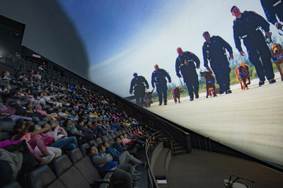 Students from Grenoble Public School enjoy an advance screening of Superpower Dogs, a new IMAX documentary film that explores the life-saving superpowers of some of the world's most remarkable dogs. The film opens at the Ontario Science Centre on April 12. (CNW Group/Ontario Science Centre)