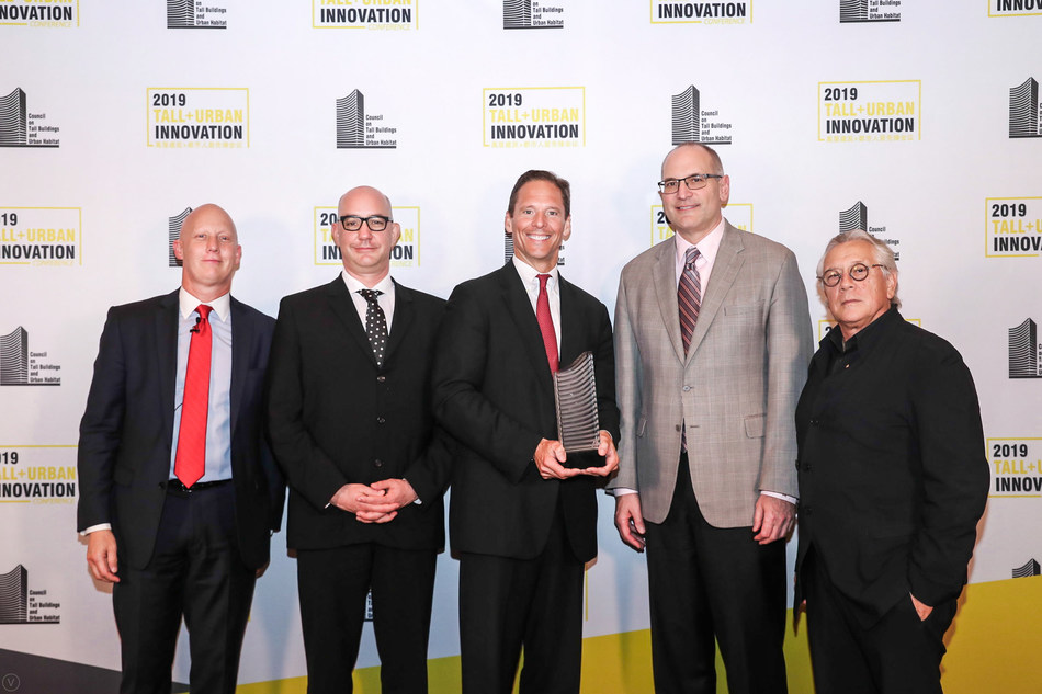 The Salesforce Tower project team pictured with their CTBUH Best Tall Building Worldwide trophy. From left to right: John Jacobs, CTBUH; Edward Dionne, Pelli Clarke Pelli Architects; Paul Paradis, Hines Interests LP; Ron Klemencic, Magnusson Klemencic Associates; and Best Tall Building Jury Chair Karl Fender, Fender Katsalidis Architects.