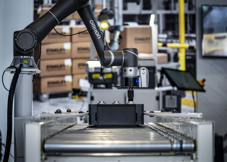 Collaborative robot picking parts.