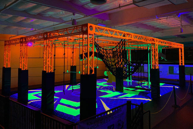 Rockin' Jump Vacaville recently debuted their new Neon Ninja Warrior Course. The course features a neon orange steel truss, neon green elements, and a custom air bag that illuminates when exposed to black lights.