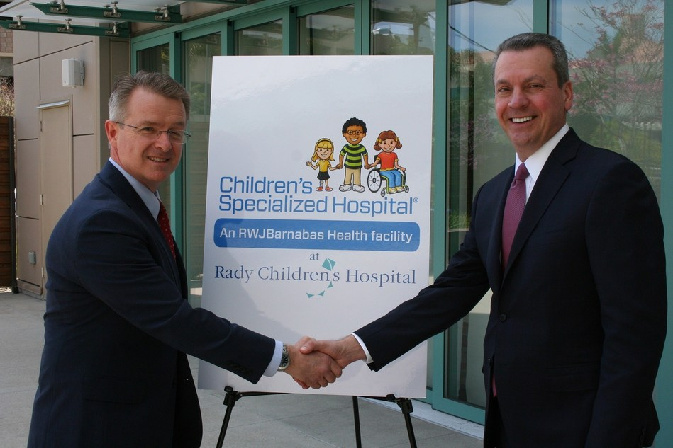 Warren Moore, FACHE, president and CEO, Children's Specialized Hospital, New Jersey,  and Patrick Frias, MD, president and CEO, Rady Children's Hospital, California, celebrate the opening of the Children's Specialized Hospital Chronic Pain Management Program at Rady Children's Hospital-San Diego.